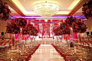 A Grand Wedding hall decorated with multiple color flowers