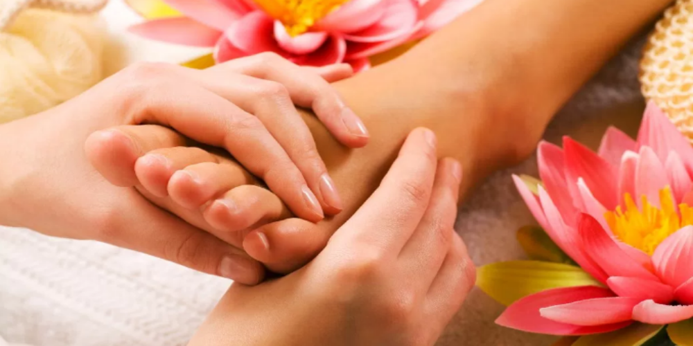 Picture that resembles a woman experiencing Foot Massage by experienced Massage Therapists.