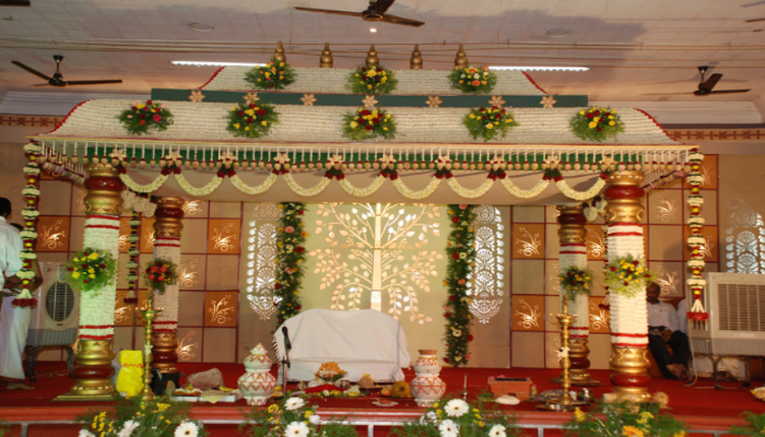 Fabulous Wedding Stage decorated with full of flowers by Leading Wedding Event Planner.